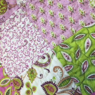 purple and green quilt
