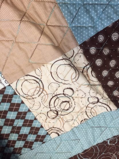 turquoise and brown quilt